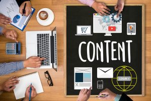 Content marketers creating new content on website and emails.