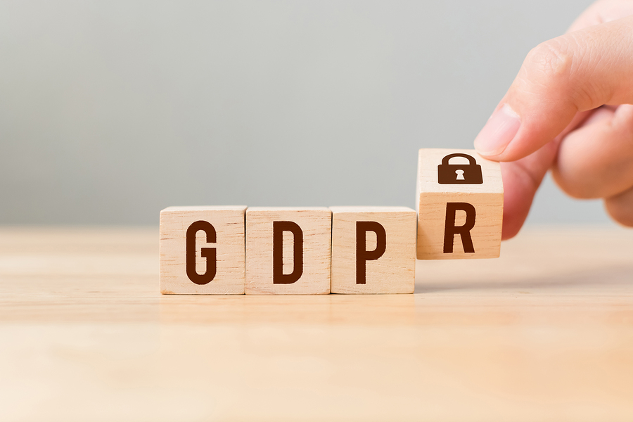 Hand flipping wooden blocks with word GDPR.