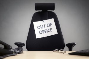 Business chair with out of office sign.